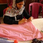 Student of Ecole D'accompagnement in dress making class