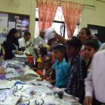 Clothes and school materials distribution at Chemin Grenier on 15th Feb 2015